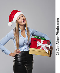Business Mrs. Claus with stack of christmas gift