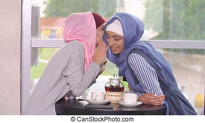 Business Muslim Women in Cafe