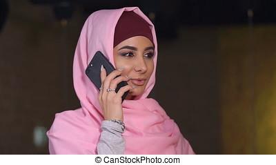 Business Muslim Women Talking at Mobile Phone