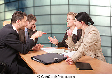 negotiations - Business negotiations - 2 men 2 women sitting...