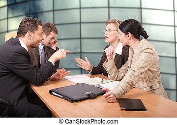 negotiations - Business negotiations - 2 men 2 women sitting...