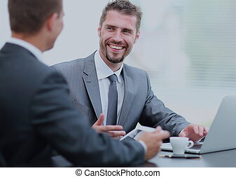 Business negotiations. Two businessmen talking in the office
