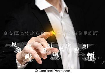 Business Network - Man touching a business network interface...