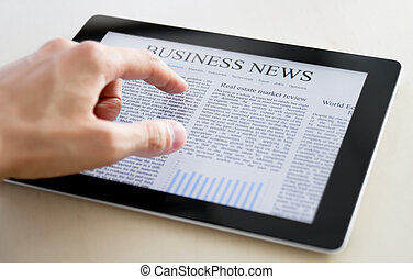 Business News On Tablet PC - Man hands are pointing on touch...
