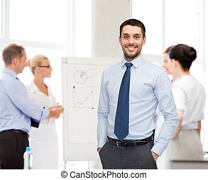 group of smiling businessmen with smartboard