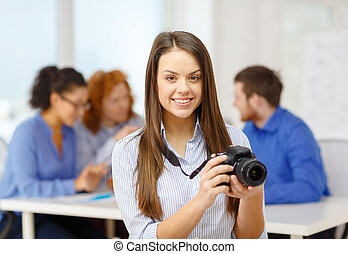 smiling female photographer with photocamera