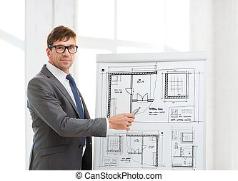 businessman pointing to blueprint on flip board