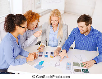 smiling creative team looking at sketch