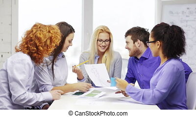 smiling creative team looking at sketch - business, office,...