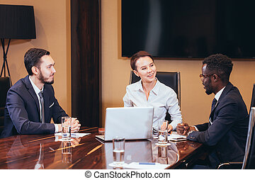 female boss talking to business team