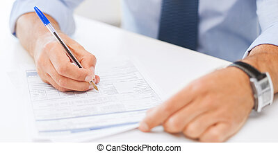 man filling tax form - business, office, school and...