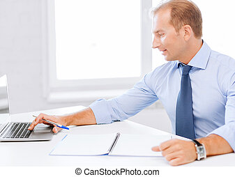 smiling businessman working in office