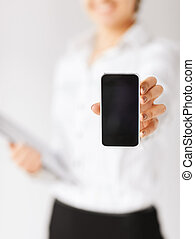 business, office, school and education concept - woman hand with smartphone