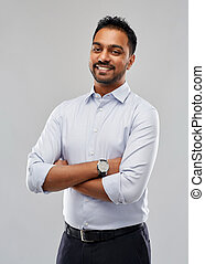 happy indian businessman in shirt over grey