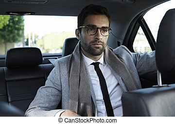 Businessman on the move in car
