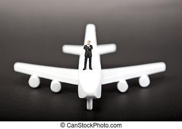 one man on plane on black