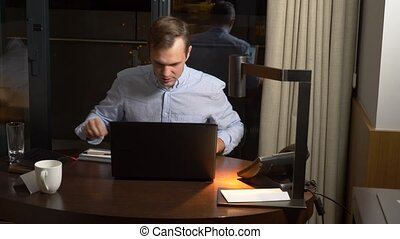 business, overwork, deadline and concept of people - a man working on a laptop at night.