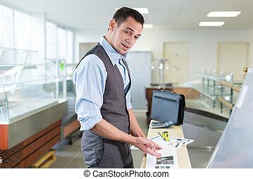 business owner and entrepreneur smiling at his desktop