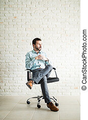 Business owner sitting on a chair