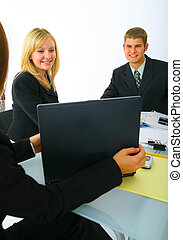 Business Partner Looking On Laptop