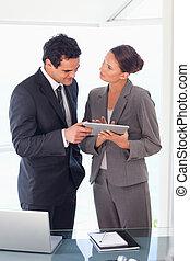 Business partner working on tablet together