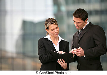 Business partners checking schedule