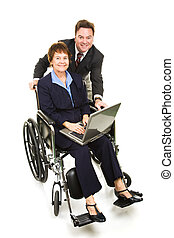 Mature business team working on the computer. The woman is in a wheelchair. Full body isolated.