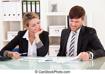 Business partners discuss sales