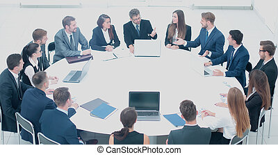 business partners discuss the modalities of signing a new...