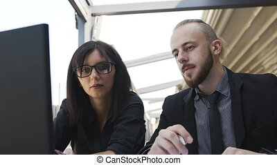 Business partners discuss the strategy of the business and build plans using a laptop computer