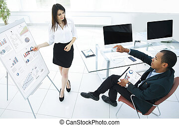 business partners discussing a new financial strategy.