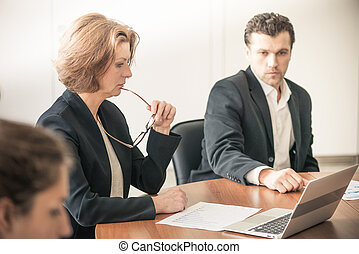Business partners discussing documents