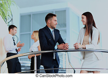 Business partners discussing while on the stairs.