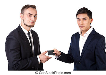 Business partners exchanging business cards