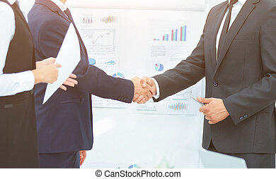 business partners greet each other with a handshake before the p