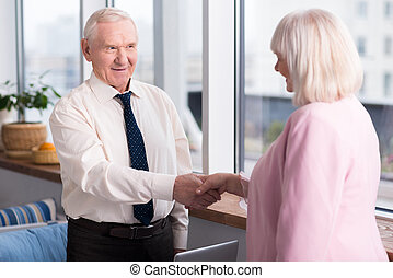 Business partners greeting each other
