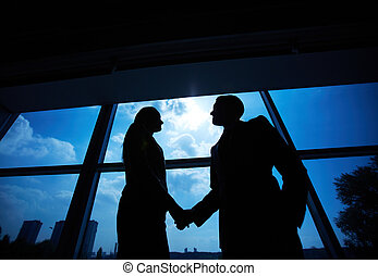 Business partners handshaking - Outlines of successful...