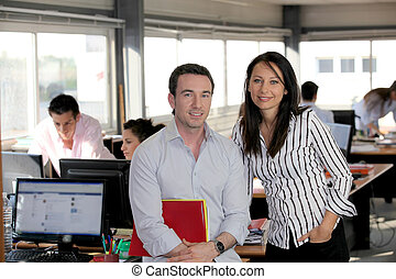 Business partners in a busy office