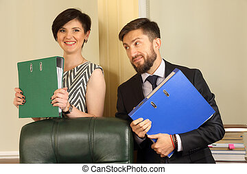 business partners in the office, holding documents