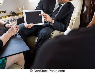 Business Partners Meeting In Private Jet
