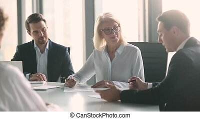 Business partners negotiate sign contract handshake at group meeting