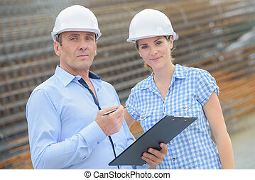 business partners posing on site