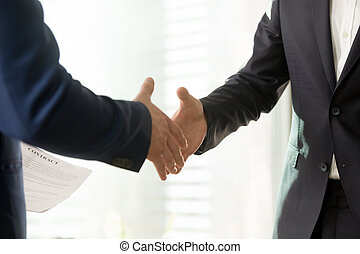 Business partners reaching consensus on meeting