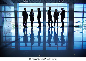 Business partners - Row of people in formalwear in the dark