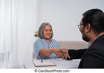 Business partners shake hands make a deal