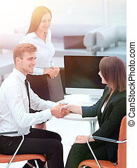 business partners shaking hands after a business meeting.