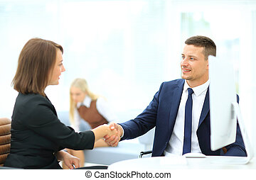 Business partners shaking hands in meeting hall - Business...