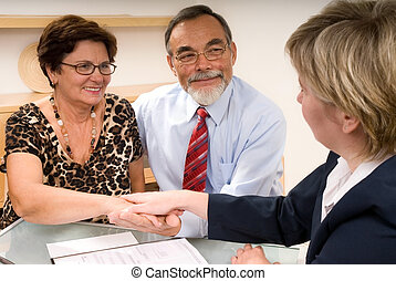 making a agreement - business partners shaking hands making...