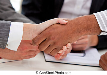 Business partners shaking hands - Close-up of business...