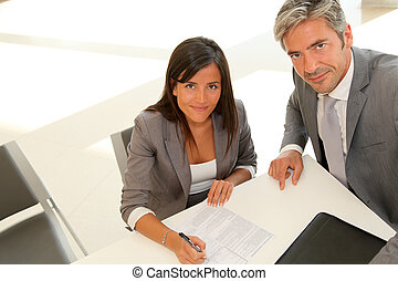 Business partners signing contract